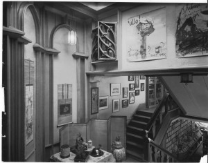 Stairway landing in the main book room, including a Maybeck gothic screen from the 1909 store.