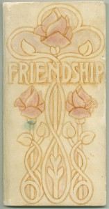 "Hand-painted cover art on 1901 edition of ""Friendship"""